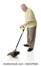 A weed whacking senior man on a white background.