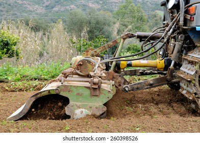 Weeding and milling of a vegetable garden with a crawler tractor