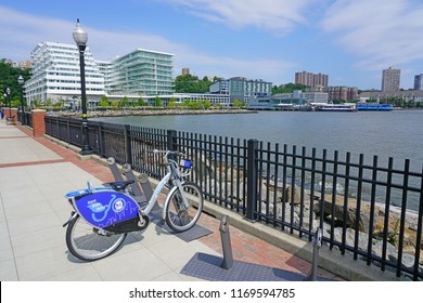 WEEHAWKEN, NJ -26 AUG 2018- View of the NY Waterway ferry terminal at Port Imperial, a transit hub on the waterfront of the Hudson River in New Jersey across from Midtown Manhattan.