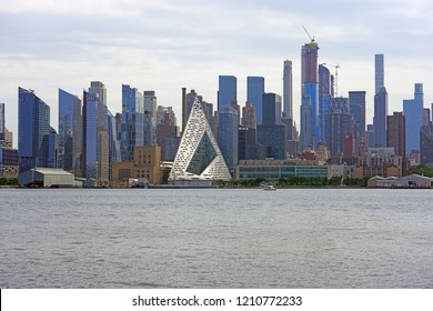 WEEHAWKEN, NJ -26 AUG 2018- View of the midtown Manhattan Hudson River waterfront skyline, including the triangle pyramid shaped Via 57 West building, seen from New Jersey.