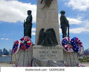 Weehawken, NJ - May 25 2019: The World War I Memorial at Hamilton Park with wreaths laid for Memorial Day commemoration