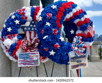 Weehawken, NJ - May 25 2019: Wreaths laid at the World War I Memorial in Hamilton Park for Memorial Day commemoration