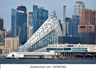 Weehawken, NJ, USA - JUNE 11, 2017: VIA 57 West seen in the New York City skyline by Danish architecture firm Bjarke Ingels Group.