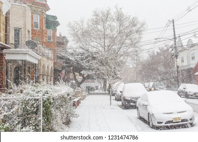 Weehawken, NJ / USA - November 15 2018: First snow fall in season, heavy snow thunder in residential neighborhood. Snow morning in residential neighborhood.