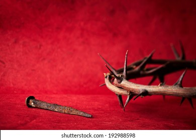 week of passion. Jesus Christ crown of thorns and a nail on red background