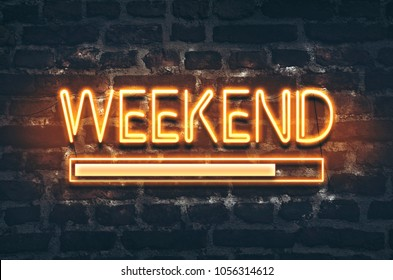 Weekend loading neon sign on dark brick wall background