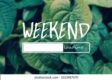 Weekend loading word on green leaves background