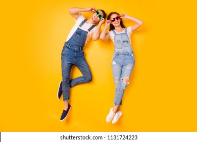 Weekend vacation holiday chill out sale discount concept. Above full length size photo portrait of two trendy cool funny funky careless excited guys in green red glasses isolated vivid background