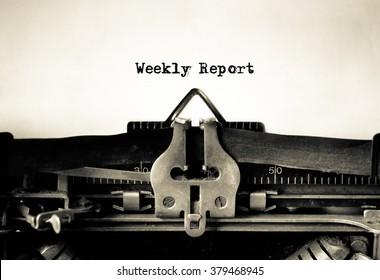 Weekly Report message typed on vintage typewriter