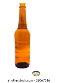 weeping bottle of fresh beer with open cork