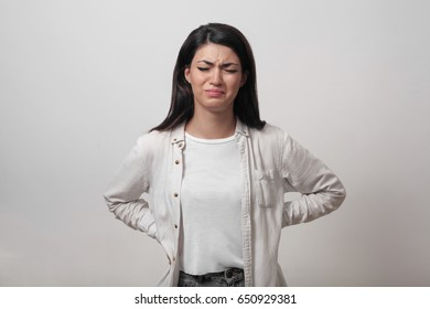 Weeping woman young brunette woman frustrated at bad news. Student girl learned about the failed test. Human face expression, emotions, attitude and reaction