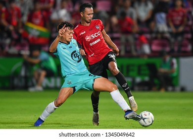 Weerawut Kayem (red)of SCG Muangthong United in action during The Football Thai League match between SCG Muangthong United and PT Prachuap F.C.at SCG Stadium on February24,2019 in Nonthaburi,Thailand