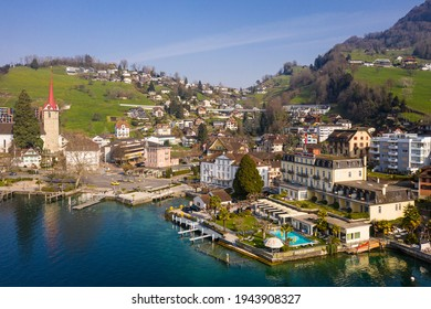 Weggis, Switzerland - March 28 2020: Aerial view of various luxury hotels such as the Beau Rivage and the Hotel du Lac that lies on the short of lake Lucerne in Central Switzerland