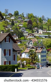 WEGGIS, SWITZERLAND - MAY 05, 2016: Residential houses in famous tourist destination that is frequently visited because of the many attractions in the town itself and its surroundings
