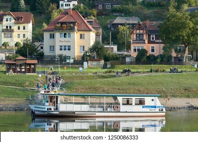 WEHLEN, GERMANY – OCTOBER 04, 2018: popular ferry service to the town of Wehlen on the banks of the Elbe in the Elbe Sandstone Mountains in Germany