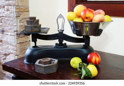 Weighing fruits on vintage scales