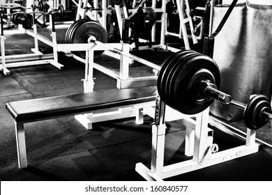 weight in dark weight room, black-and-white horizontal photo
