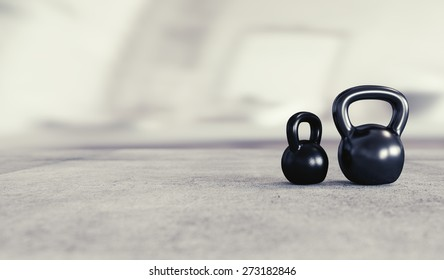 Weight lifting background image with two kettlebells and space for text.