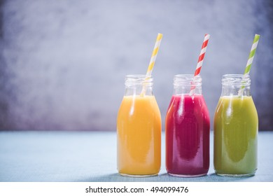 Weight loss concept, smoothies selection in glass bottles