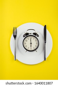 weight loss or diet concept. stock image of alarm clock on plate