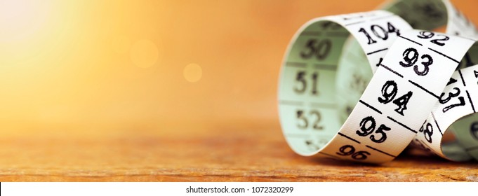 Weight loss, diet concept - web banner of a measuring tape with blank, copy space