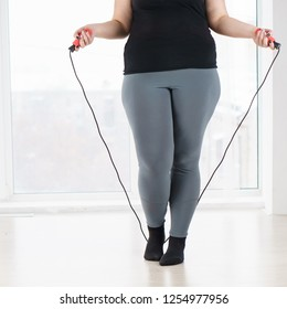 weight loss, endurance, jump-fit, vitality, active lifestyle. overweight woman with jumping rope cardio workout