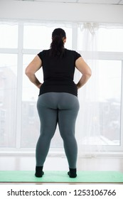 weight loss, fitness, sport, exercising, training and lifestyle. young plus size woman before home workout