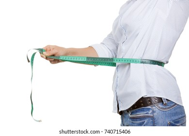 Weight Loss and Healthy Lifestyle Concept. Fitness Woman Measuring Her Waistline with Measure Tape extreme closeup