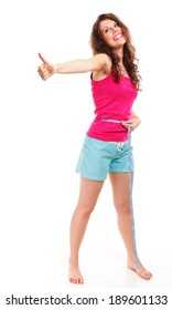 Weight loss young sporty fitness woman with measure tape giving thumbs up success hand sign full length isolated on white background