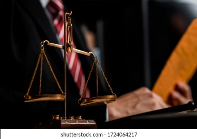 Weight scale of justice, Lawyer businessman working on table office, Justice and law concept.
