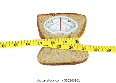 Weight scale with wholesome slice of bread and measuring tape on white background
