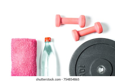 Weight training equipment on white background. Training weights, dumbbells, bottle of water, towel
