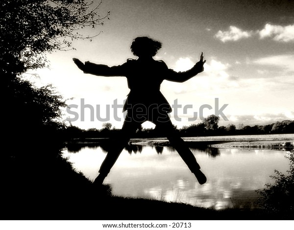 Weightlessness: A girl between heaven and earth at the river Thames.
