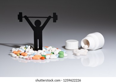 weightlifting pictogram with pills and gray background