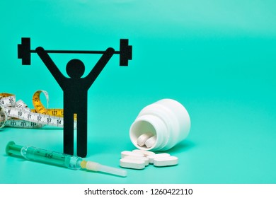weightlifting pictogram with pills and yellow background