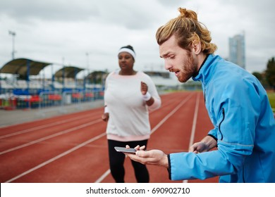 Weight-loss trainer measuring time of run
