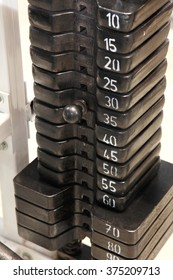 weights equipment on fitness machine in the gym