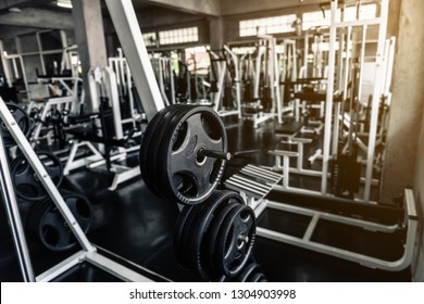 Weights lifting rack in club fitness gym., Bodybuilder equipment barbell for shoulders muscle exercising and workout machine background., Leisure activities and sport lifestyle concept.