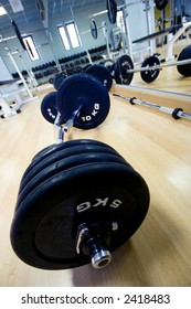 weights on a gym floor ready to by left