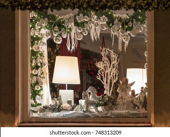 Weilheim, Germany - November 26, 2015: European Christmas shop window decoration with traditional porcelain figurine toys and balls