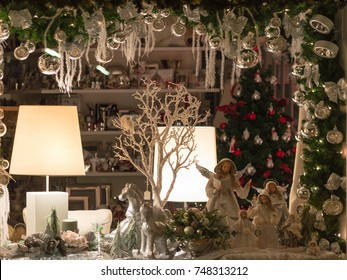 Weilheim, Germany - November 26, 2015: Christmas holiday shop-window decoration with traditional porcelain figurines Christmas tree toys and balls