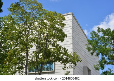 Weimar, Germany 07-27-2021  Bauhaus Museum architecture with trees and inscription on the facade