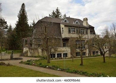 WEIMAR, GERMANY - APRIL 12, 2016. Haus Hohe Pappeln historic building in Weimar, with vegetation in front of the building. Architect, designer and painter, Henry van de Velde, lived in this building.