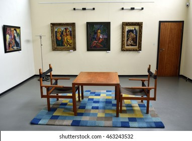 WEIMAR, GERMANY - APRIL 13, 2016. Interior of the Bauhaus Museum in Weimar, with Bauhaus designer chairs and table, carpet and paintings.