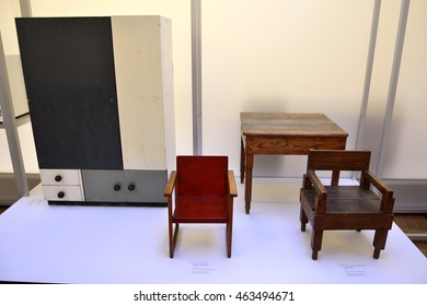 WEIMAR, GERMANY - APRIL 13, 2016. Bauhaus chairs and cupboard from 1920s, on display at the Bauhaus Museum in Weimar.