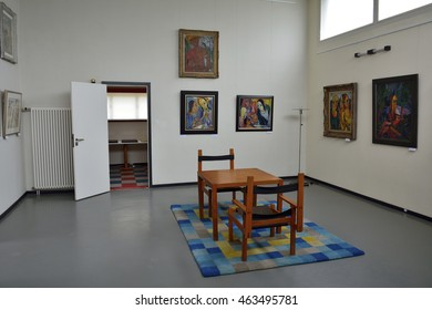 WEIMAR, GERMANY - APRIL 13, 2016. Interior of the Haus am Horn building in Weimar, with Bauhaus designer chairs and table, carpet and paintings.