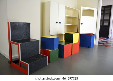 WEIMAR, GERMANY - APRIL 13, 2016. Interior of the Haus am Horn building in Weimar, with multi-color geometrical cubes, cupboard and doors.