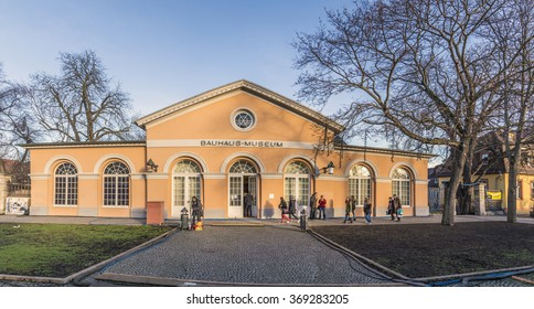 WEIMAR, GERMANY - DEC 19, 2015: people visit the Bauhaus museum in Weimar, Germany, It is placed at a classicistic house built by Clemens Wenzelslaus Coudray.