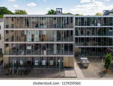 "Weimar, Germany - May 26 2017: ""Kuben"" a new building of Bauhaus-Universität Weimar, faculty ""Architecture"". Erected 1998-2001 upon drafts of the architect agency ""Architekten AV1"", Kaiserslautern."