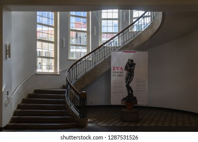 """Weimar, Germany - May 26 2017: Spiral staircase in the main building of Bauhaus University Weimar (german: """"Bauhaus-Universität Weimar"""")"""